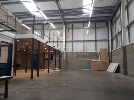 The property comprises a steel portal framed industrial unit being clad in profile metal sheeting under a pitched sheet clad roof incorporating translucent roof lights. Internally, the property comprises open plan works space with an eaves height of...