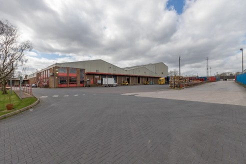 An extensive 3 bay detached warehouse with additional extension and a detached office and storage unit on a site of 5.823 acres. Extensive loading and parking facilities are available.  The main warehouse is constructed of a steel portal frame with b...