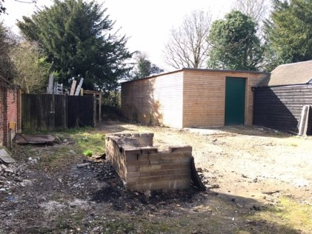 The property comprises a timber clad workshop with concrete floor, strip lights, roller shutter door (1.7m wide) and WC.  Outside there is a yard space secured on all sides together with large timber gate providing access from Ayres Lane.  Outside of...