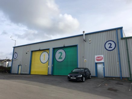 The property comprises two adjoining industrial/warehouse units being constructed on a steel portal frame with block and metal sheet clad walls and under a pitched sheet clad roof incorporating translucent panels.  Each unit has a drive in roller shu...