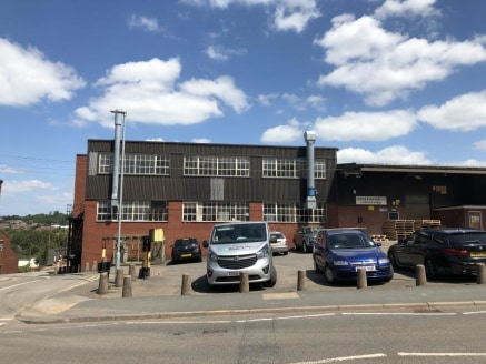 The property comprises three inter-linking industrial buildings situated on a self-contained site area with a service yard/car park located to the front elevation.\n\nThe available areas are described further overleaf and form the lower ground floor....