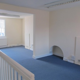 p>\n From Rother Street you enter the office building into a lobby which leads into the reception room with bay window and glass blockwork screened wall. Beyond this room is a further office area with stairs to the first floor....