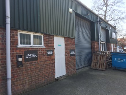 The property comprises a single mid-terraced unit which forms part of a terrace of four units, and is of steel portal frame construction incorporating part brick/profiled steel cladding beneath a pitched roof with a roller shutter loading door.   Int...