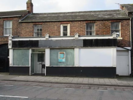 The property comprises a two storey brick built retail unit set within a terrace of similar buildings. Internally the accommodation is divided to form a ground floor sales area with rear storage/staff facilities. To the first floor there is an additi...