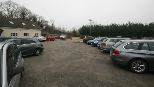 The property comprises a modern warehouse/industrial unit with loading door, 6.5m eaves height, 3 phase power, offices, canteen and wc's, older style warehouse and a large, secure surfaced yard to the rear.   At the first floor are large open plan an...