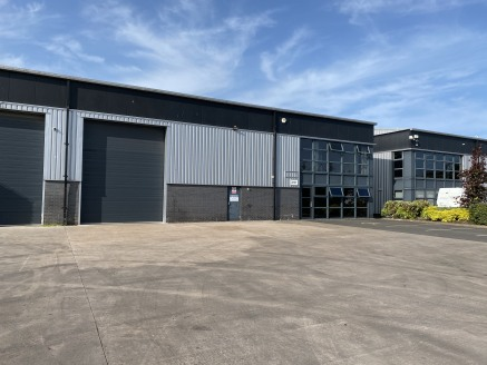 The industrial / warehouse unit incorporates reinforced concrete floors, brick / concrete block and insulated cladding to the walls / roof which incorporate GRP roof lights. The internal eaves height is approximately 6.3 metres and loading access is...