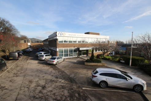 Well located prominent freehold offices on a generous site area. Comprising two linked structures of concrete frame construction underneath pitched and flat roofs. the property is surrounded by well maintained landscaped gardens and tarmac surfaced v...