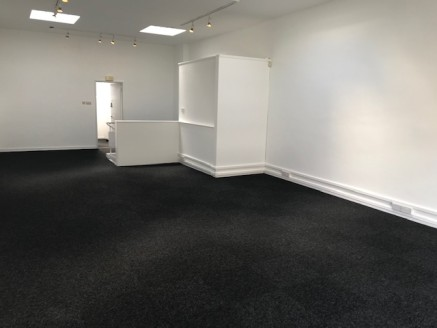 The property comprises a two storey mid terraced retail unit. The ground floor has a recessed entrance with ramped access from Mayflower Street which leads to an open plan sales area with staircase. There is access to the first floor level and a rear...