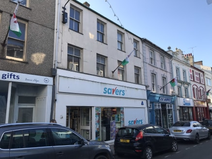 Prominent retail unit comprising 1,900 sq ft to let/for sale in Pwllheli.  The property is available by way of a new effectively Full Repairing and Insuring lease at a rent of £12,000 per annum.  Alternatively, the property is for sale freehold at £1...