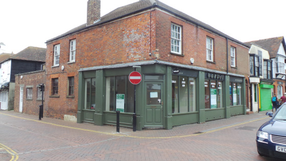 This unit is the ground floor retail area of a substantial two storey brick building situated on the corner with Gilbert Road. It has brick external elevations beneath a pitched, tiled roof and benefits from an enclosed yard with access from Gilbert...