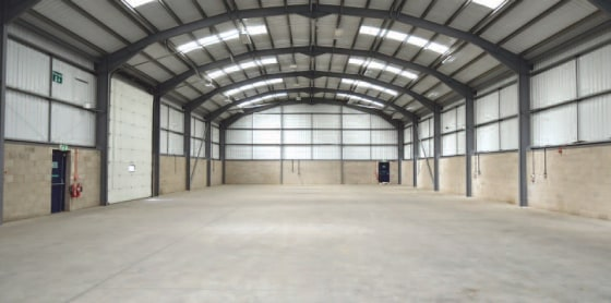 A modern detached warehouse with a Large secure concreted yard.\n\nThe unit is of single span construction and is approximately 5....