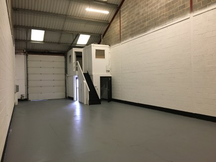 The property comprises part of a modern terrace of industrial units of steel portal frame construction with external cladding of brickwork and profile metal sheet. The premises benefits from: