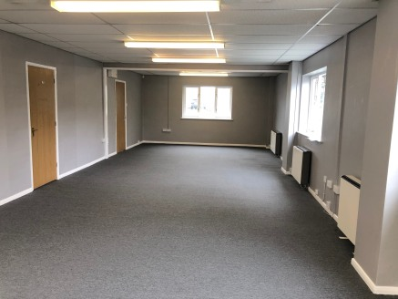 A modern, detached manufacturing/warehouse facility with offices with dedicated service yard.  9,580 sq ft  £39,500 per annum or freehold on application  Large Secure Yard