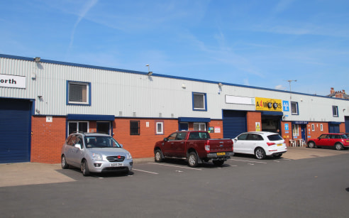 The estate comprises a terrace of single storey industrial units constructed of a steel portal frame with blockwork and profile sheet cladding to the side elevations. Unit 9 benefits from: