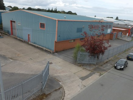 A modern, detached industrial / warehouse unit with large yard and separate dedicated parking on a site of 0.7 acres.  12,231 sq ft  Leasehold - £57,500 per annum.