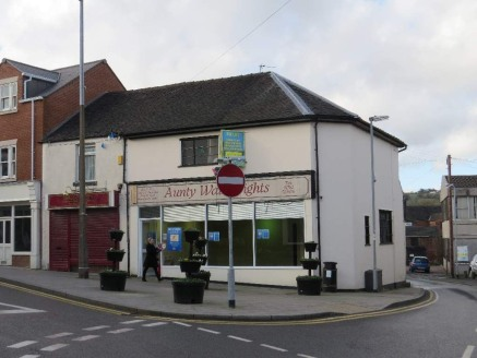 A very well presented retail premises with A2 content (professional offices) briefly comprising a ground floor sales / office area together with rear storage plus a range of offices, kitchen and WC at first floor level. Externally there are three sto...