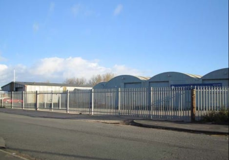The complex comprises two distinct areas in need of complete refurbishment.   A former factory shop warehouse, which is of steel portal framed structure, with concrete wall panels under a pitched roof, with an eaves height of approximately 4.1 metres...