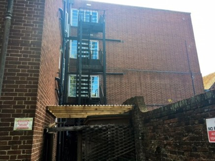 The property comprises 2 ground floor retail units and 3 residential floors above.  The residential floors are split to provide 4 studio apartments on each floor - 12 in total.   There is parking and further land at the rear which fronts the Kennet a...