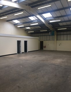 The property comprises two adjoining steel portal framed industrial units with concrete block and brick walls plus external profile metal cladding with a reinforced concrete floor, beneath insulated roofs incorporating roof lights. The units also ben...