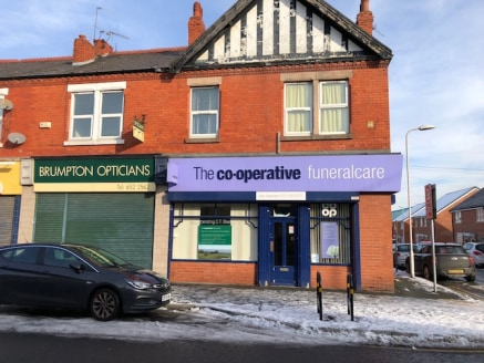 The unit forms part of a two storey property and comprises a small ground floor corner retail unit. Internally the shop has a number of small rooms with additional staff area and w/c. To the rear of the unit is a storage and loading area.     On stre...