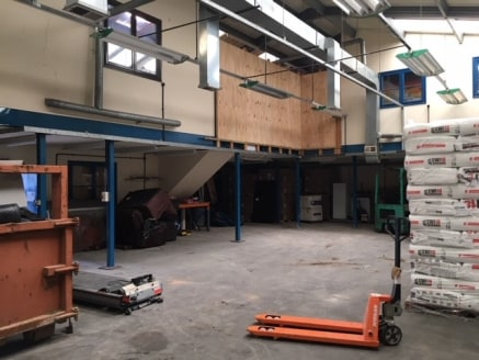 The property comprises a steel portal framed workshop with first floor mezzanine office/storage space The building comprises profile metal clad walls and roof. Internally the property has a concrete ground floor with steel first floor mezzanine, thre...