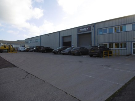 The property provides a modern industrial premises benefiting from a large surfaced and fenced front yard. The unit is accessed via two roller shutter doors to the front elevation and has an internal eaves height of approx. 6.2m (5....