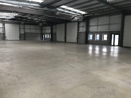 The property comprises of a end terrace industrial premises benefiting from modern office space, including kitchen and W.C and is accessed via the warehouse accommodation with electric roller shutters to 5 metres, opening out to a generous shared yar...