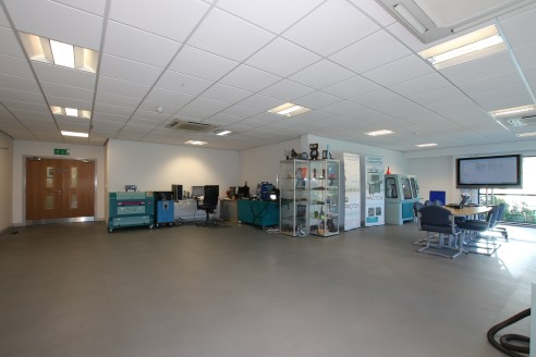 The property comprises a very high quality industrial building with excellent office accommodation, built around a steel portal frame, heating, lighting and air-conditioning installed throughout the offices which also have raised access floors. Fire...
