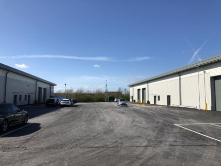 The property is part of a newly built industrial development consisting a series of terraced, trade counter units completed to a shell finish, constructed of steel portal frame with a combination of masonry and profile clad elevations beneath a pitch...