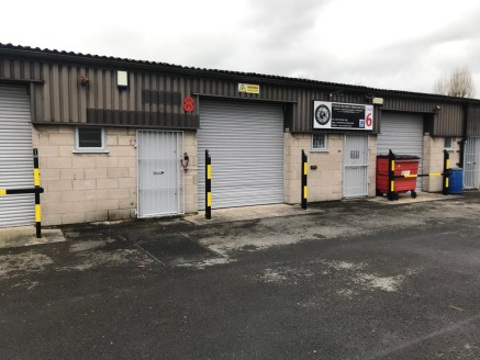 The unit is single-storey, of concrete block and steel construction, set beneath an asbestos cement roof. The unit has toilet facilities, a manual roller shutter door and would be suitable for production, storage or light assembly.   Use for vehicle...