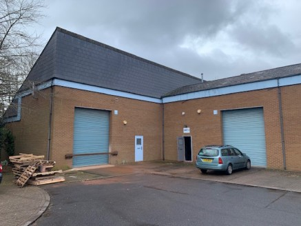 The units are situated at right angles to each other and have brick external elevations and high pitched artificial slate roofs covering with inset lights, roller shutter door access and parking provisions.