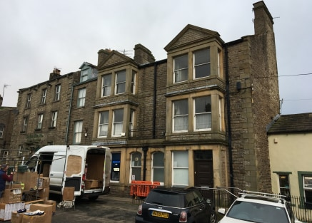 The property comprises a substantial three storey stone built former banking premises under a pitched slate covered roof. Internally the accommodation briefly comprises a banking hall, vault, office and stores at ground floor level, with three office...