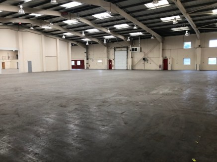 Modern warehouse/industrial unit  26,950 sq ft  Benefits from two storey offices and large yard.  £170,000 per annum