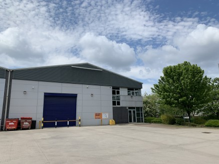 The property comprises a steel portal framed warehouse premises under a single bay profiled metal sheet clad roof and incorporates Perspex roof lights supported on clear span RSJ's. The outer walls are clad in composite panelling.  Internally, the ac...