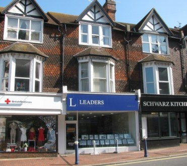 The property offers a prominent mid terraced four storey building of brick block construction with part tiled elevations under a pitched tiled roof. The lower ground, ground and first floor are let to Leaders Ltd.