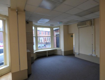 A superbly presented prominent ground floor retail unit, which was previously used as the post office.