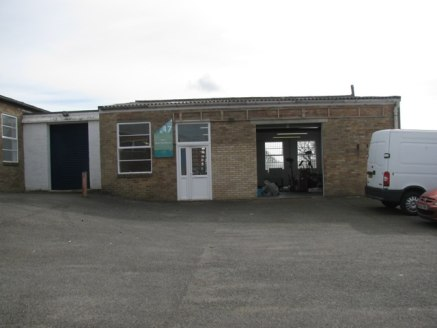 The premises comprise a self-contained concrete frame unit with brick elevations under a corrugated pitched roof. Location The unit is located on the well established Station Road Industrial Estate which is on the southern side of Station Road.
