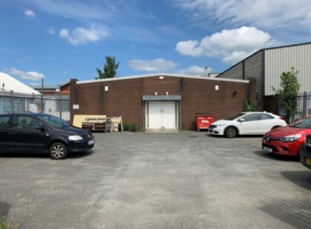 A detached single-storey warehouse unit with 2-storey offices attached to the front.<br><br>Constructed of a steel portal frame with cavity brick walls and a pitched profile steel clad roof incorporating 10% translucent panels providing good natural...
