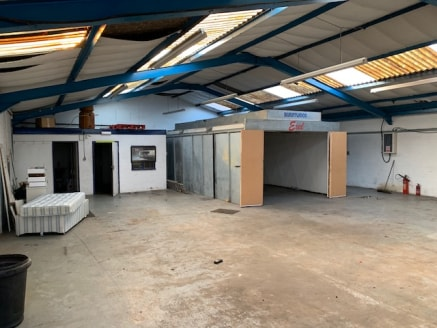 The property comprises an end of terrace, single storey, steel framed, brick built workshop/warehouse unit with a pitched corrugated asbestos roof incorporating translucent roof lights. To the rear of the property there is an office block and WC. The...