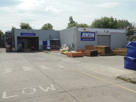 Former Jewson Builders Merchant Site. Large Site Area 0.75 Acres. 809.8 sq m (8,717 sq ft). Popular Trade Location. Long Leasehold Interest Available.