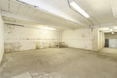The property comprises a single arch amongst a 5 arch run off of Coldharbour Lane. The arch is split over ground and first floor, fully lined, with a concrete floor and has electricity, lighting and water services. Access is via the manual roller shu...
