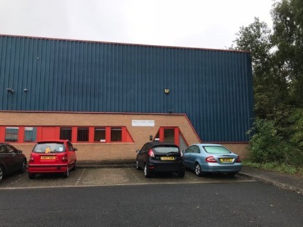 The property comprises a semi-detached industrial/warehouse premises of steel frame construction with brick/block and steel clad elevations beneath a steel clad roof incorporating translucent roof panels. The warehouse has a minimum eaves height of a...