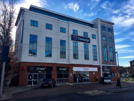 Prominent Retail / Takeaway Unit Under Travelodge Hotel  The property comprises a retail showroom previously traded as a takeaway operation. The property benefits from A1, A3 & A5 planning permission. A2 use under permitted development may be achieva...