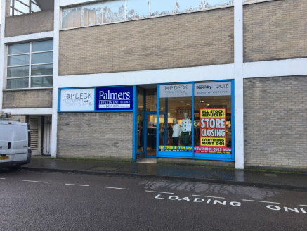 The property comprises a substantial former department store on  ground and three upper floors benefitting from large, open plan  sales areas, ground floor escalator, goods lift and rear servicing via  Grove Road, fitted café and wc/wash facilities.