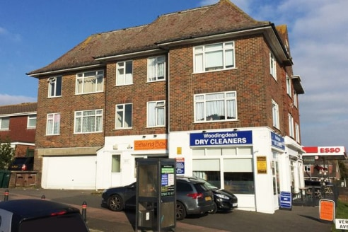 Situated in a prominent position on a busy arterial route, close to an extensive parade of local shops and a busy Tesco Esso Express service area. Frequent bus services serve this location, and Woodingdean Library, the Nuffield Hospital, Downs View ....