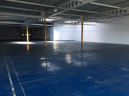 The premises is a middle unit in a terrace of three which are of steel portal frame which has fully insulated cladding and comprises of a factory area and reception office on the ground floor. Whilst the first floor has offices only.
