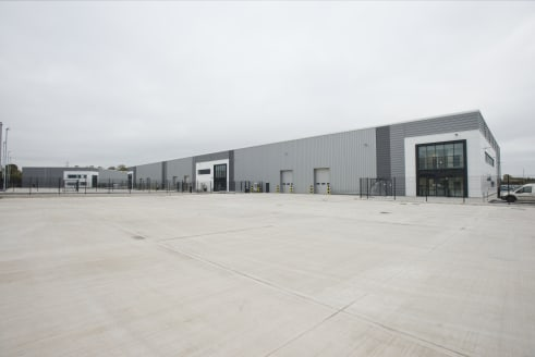 Steel portal framed buildings with feature glazing to offices. 7-8 metres internal eaves height. Electrically operated level access loading doors. 37.5 KN/m2 floor loading. All mains services and drainage connections. Separate dedicated car parking a...