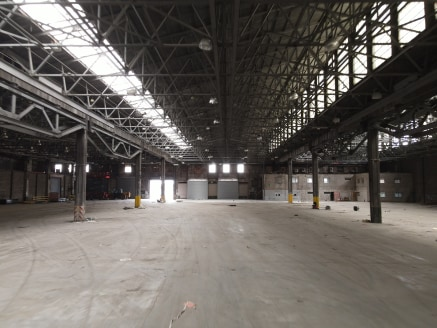 Average clear headroom 9.5m (31ft). High bay sodium lighting-Solid concrete floor. Excellent loading areas. Drive-in roller shutter loading doors. Extensive yard /circulation areas.