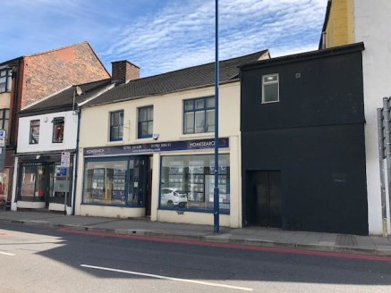 The property comprises a self-contained, double fronted mid-terrace property of traditional masonry construction beneath a pitched and tiled roof surface. The property benefits from the following characteristics;\n\n- Two open plan retail areas\n- An...
