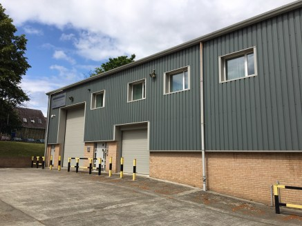 The property briefly comprises a high bay modern portal frame industrial unit benefiting from a solid concrete floor with an up and over electric door and a minimum working eaves height of 8.4m. Internally the premises benefits from modern offices wi...